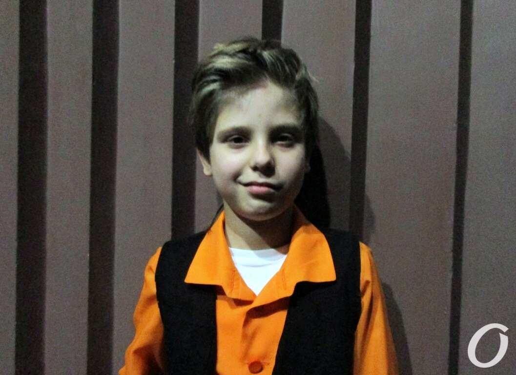 юный актер Роман
